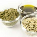 bowls of hemp oil, hemp powder and hemp seeds